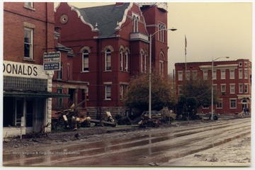 Debris, damaged cars, mud, and water remain in the street in front of the courthouse in Parsons, W. Va. The damage occurred during the November 1985 flood in the area around Parsons, Elkins, Onego, and Mounth of Seneca, W. Va.