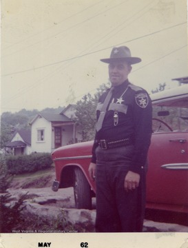 Billy Sirk, in uniform as Deputy Sheriff of Monongalia County, W. Va.