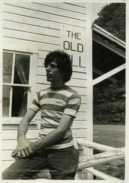 Lester Lind poses for a picture at the Old Mill Crafts Shop in Harmon, W. Va.The photos in this collection were used in chapters that appeared in Mountain Trace, a publication of Parkersburg High School in West Virginia, edited by Kenneth G. Gilbert.