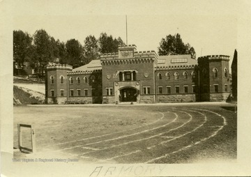 This image is part of the Thompson Family of Canaan Valley Collection. The Thompson family played a large role in the timber industry of Tucker County during the 1800s, and later prospered in the region as farmers, business owners, and prominent members of the Canaan Valley community.View of West Virginia University's Armory building.
