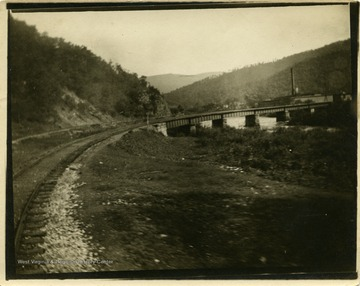 This image is part of the Thompson Family of Canaan Valley Collection. The Thompson family played a large role in the timber industry of Tucker County during the 1800s, and later prospered in the region as farmers, business owners, and prominent members of the Canaan Valley community.Scenic view of the Keyser Curve along the Western Maryland Railroad.