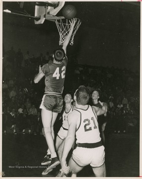 Jerry West led the East Bank High School basketball team to its first ever state championship victory as its starting small forward. He was named All-State from 1953–56, then All-American in 1956 when he was West Virginia Player of the Year, becoming the state's first high-school player to score more than 900 points in a season.West was born in Cheylan, W. Va. in 1938. After high school, he went on to play basketball for West Virginia University and then rose to fame as a player for the Los Angeles Lakers of the NBA before becoming a basketball coach and manager.