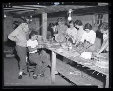 A group of campers work together during the class activity. Subjects unidentified.