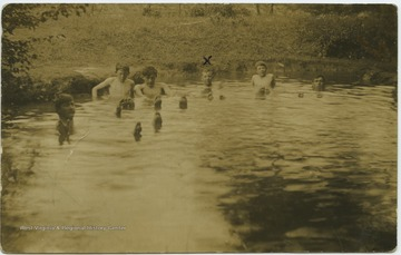 "Miller, marked on the photo with an ""x"", swims with his friends in the river."