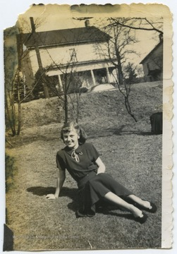 DeWitt relaxes on the grass during her senior year at Terra Alta High School.