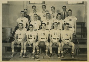 In the first row, from left to right, is: Paul Cooper; Richard Fraley; Ronald Everly; Robert Harmon; Jack Hill.In the second row, from left to right, is: Don Groves; Frank Lambert; David Metheny; Clifford Lambert; Charles Glotfelty.In the third row, from left to right, is: Robert Feather (manager); Lawrence Smith; Eugene Auman; Arthur Sisler, Coach Fred C. Carrol.