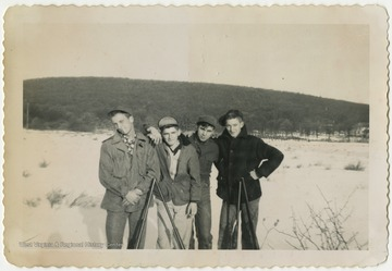 "Terra Alta High School students Paul Cooper, Richard Fraley, Clifford Lambert, and ""Weed"" Arthur Sisler pose together during a hunting trip."