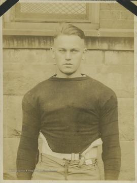 An unidentified West Virginia University football player is pictured in his practice gear.