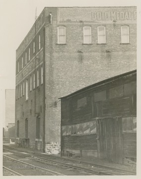 Rear of the Morgantown Flour & Feed Co., which is alongside the railroad tracks.