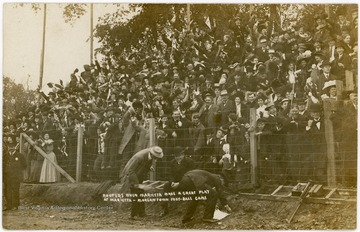"""Rooters when Marietta made a great play at Marietta - Morgantown foot-ball game."" Photo postcard."