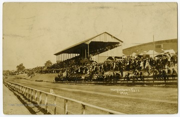 A view of the racetrack and grandstand at the old fairgrounds, located in Star City, during the 1909 Morgantown Fair.