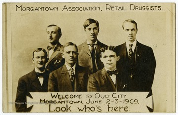 Six druggists pose for a formal group photo.