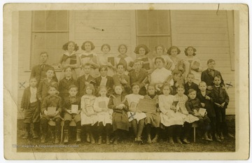 The students of the Easton School pose outside of the school building, located in Easton, near Morgantown, W. Va.