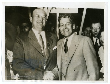 "Text on back reads, ""Louis A. Johnson, left, of Clarksburg, West Virginia, being congratulated by his predecessor Henry L. Stevens, after his election as national commander of the American Legion at the Portland, Oregon convention."""