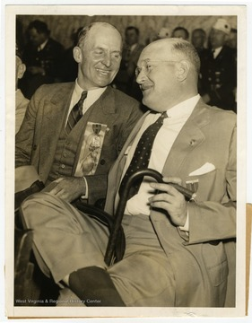 "Text on the back reads, ""Two men who in turn ruled the destinies of the  American Legion are pictured enjoying a pre-convention chat at Cleveland, where the legion opens its annual convention today, Sept. 21. At left is Hanford McNider, who was national commander in 1922, and at right, Louis A. Johnson, who held that high office in  1932. He hails from Clarksburg, W. Va., and is chairman of the Veterans' Committee in the Democratic Party."""