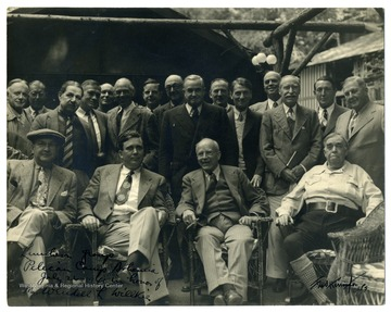 A group portrait of those attending a luncheon honoring Mr. Wendell L. Willkie, the 1940 Republican nominee for the presidency, at Pelican Camp, part of the Bohemian Grove complex in California. Louis Johnson, later Secretary of Defense, is pictured seated on the far left, next to Willkie.