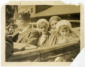 Louis Johnson pictured in a car with his wife Ruth Frances Maxwell Johnson and his daughters Lillian Maxwell Johnson and Katherine Ruth Johnson, likely during his tenure as National Commander of the American Legion.