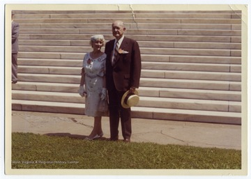 Louis and Ruth Johnson at the Fiftieth Anniversary of the Class of 1912, pictured at the foot of the Rotunda steps at the University of Virginia, Charlottesville.