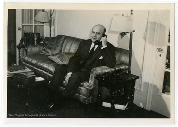 "Text on the back reads, ""When Assistant Secretary of War, Col. Louis Johnson was famous as hard worker, hard driver. During preparations for important mission to aid India in fighting off Japanese, the telephone in his Washington apartment was seldom silent."" Johnson served as the President's personal representative in India in 1942."