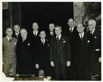 Pictured left to right: Ray Murphy, Ed Spafford, Ralph T. O'Neill, General James A. Drain, Stephen Chadwick, Harry Colmery, Raymond J. Kelly, John R. Quinn, Louis Johnson, Paul McNutt.