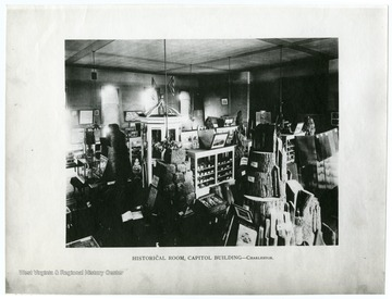 The photo shows a room in the Capitol Building where artifacts of import in West Virginia's history are stored.